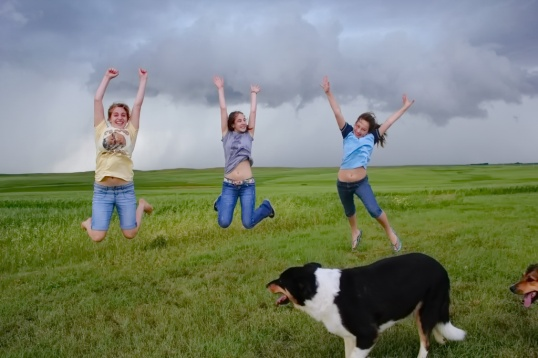 The girls enjoying one last prairie storm before our big move to the city.