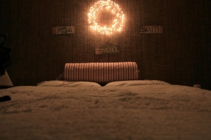 Chenille bedspread-thrifted.IKEA lighted wreath. Cozy.