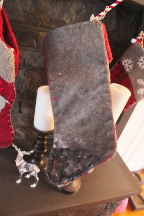 And this- this is what happens when stockings get too close to heat. It happened 2 years ago in our last house with a gas fireplace.  Perfectly imperfect, right?